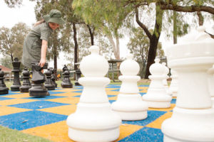 Students playing giant chess during lunchtime at St Francis Xavier's Catholic Primary School Lurnea