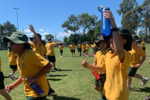 Two students playing soccer on field at St Francis Xavier's Catholic Primary School Lurnea