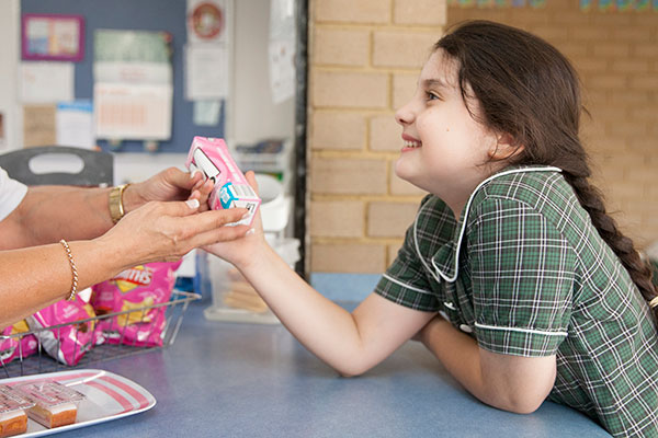 Student ordering a snack at the St Francis Xavier's Catholic Primary School Lurnea canteen