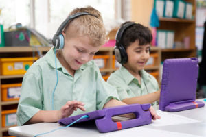 Two students at St Francis Xavier's Catholic Primary School Lurnea working on tablets