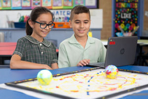 Two students painting with robotics at St Francis Xavier's Catholic Primary School Lurnea