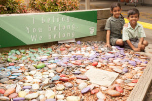 Two students at St Francis Xavier's Catholic Primary School Lurnea sitting in front of school values