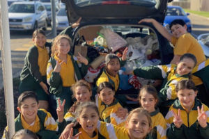St Francis Xavier's Catholic Primary School Lurnea students packing a car full of food for donation